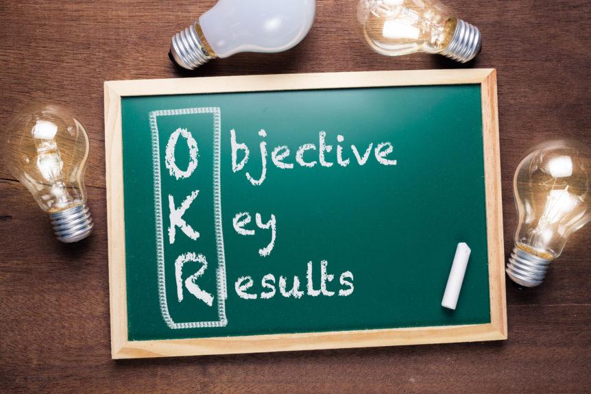 OKR or Objective Key Results acronym text on chalkboard with many glowing light bulbs, washington dc, crosslead